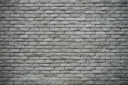 The texture of gray wall made of bricks use for background