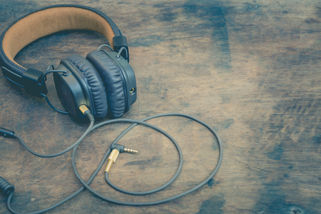 The vintage headphones for listening to music, sound engineering concept