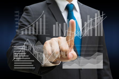 Businessman hand touching the virtual panel of pie chart and other chart , business concept Imagens