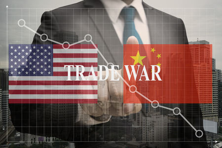 Double exposure of Businessman , trade war between the biggest economies, us and china make the world be economic crisis concept