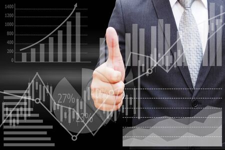 Businessman hand thumbs with the virtual panel of pie chart and other chart , business concept