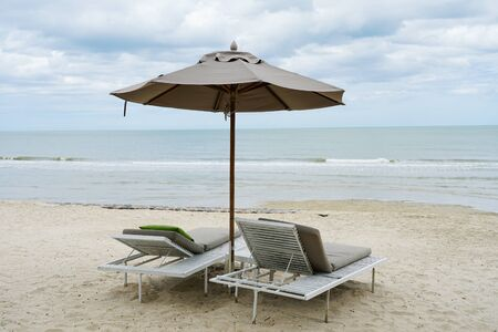 Beach chairs under ambrella on holiday