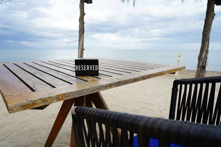The reserved table at restaurant in fornt of beach