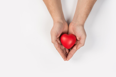 close up man hands with heart on white background