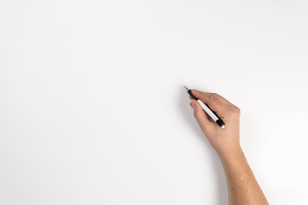 Close-up hand writing with a pencil, brown wooden pencil in hand, isolated on white background with clipping path