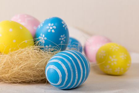 Easter eggs with colored eggs in nest. Easter holiday concept.