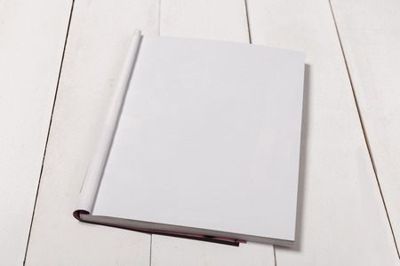 Mock-up magazine or catalog on wooden table. Blank page or notepad on wood background. Blank page or notepad for mockups or simulations