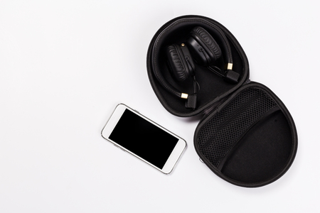 black Headphones and Smartphone on white isolated background. Music concept