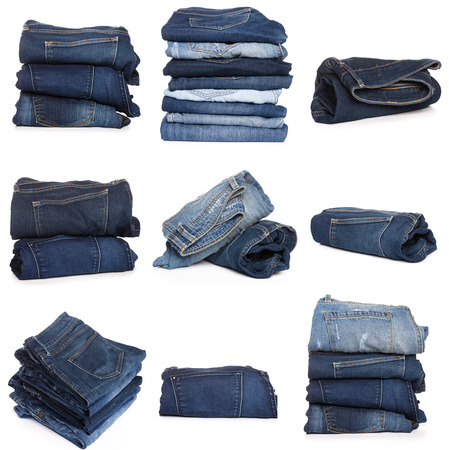 Collection of folded jeans isolated on white background Stock Photo