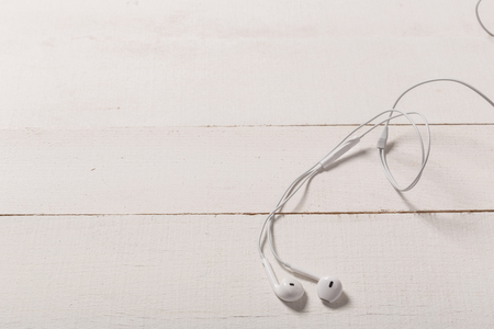 White headphones on a white backgroundTop view. Flat lay. Copy space. Music concept Reklamní fotografie