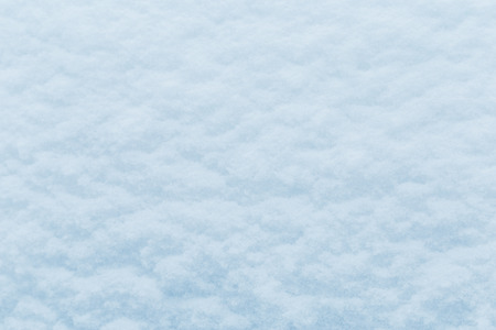 Winter snow. Snow texture Top view of the snow. Texture for design. Snowy white texture. Snowflakes. Фото со стока