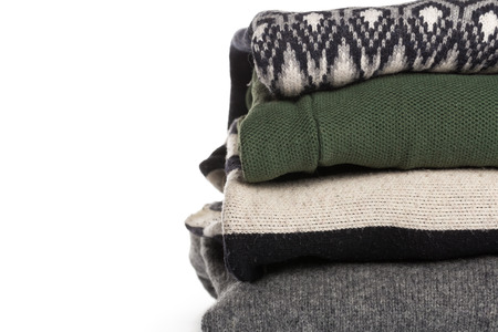 different knitted sweaters on a isolated background