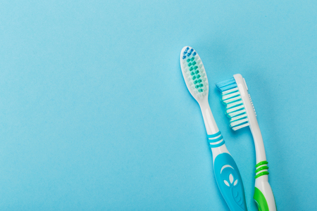 Two new toothbrush on a blue background. Dental concept Фото со стока