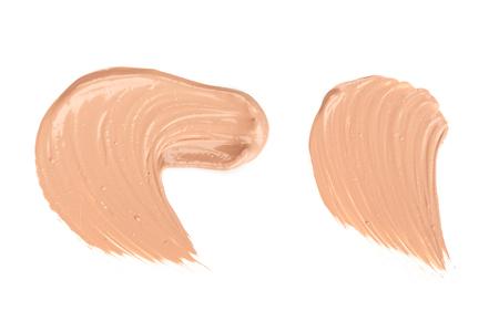 Liquid foundation strokes isolated on white background