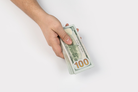 woman hand with dollars isolated on a white background