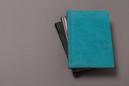 top view of a open notebook with pencil on a gray background. Office notepad flat lay
