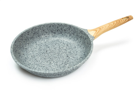 Photo of a ceramic frying pan with a wooden handle isolated on a white background. Reklamní fotografie