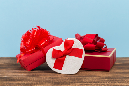 Festive gift box on blue background. Festive greeting card.