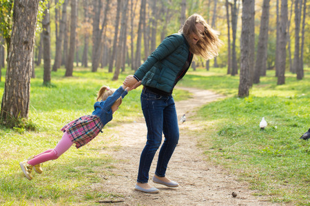 happy mother playing with his daughter in the park  in summer day Reklamní fotografie