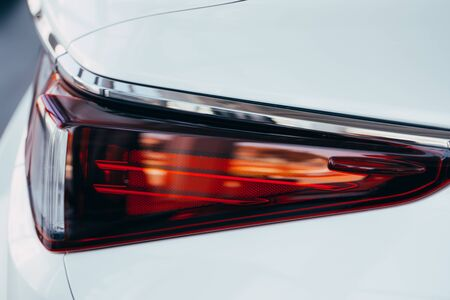 Closeup of car tail light on a white car
