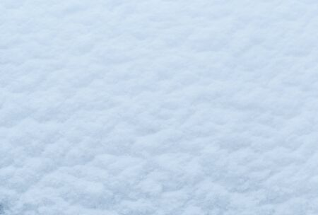 Winter snow. Snow texture Top view of the snow. Texture for design. Snowy white texture. Snowflakes. Standard-Bild