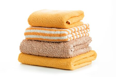 A stack of towels yellow  on a white background