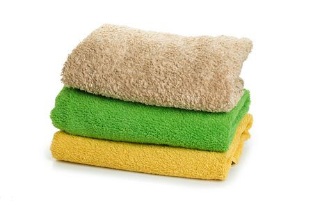 Stacked coloful  towels isolated on white background