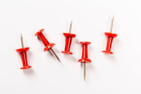 set of red push pins isolated on white background.