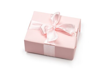 Gift box wrapped in pastel paper with pink ribbon on white. Top view