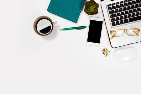Modern workspace with coffee cup, smartphone, paper, notebook, tablet and laptop copy space on white color background. Top view. Flat lay style. Zdjęcie Seryjne