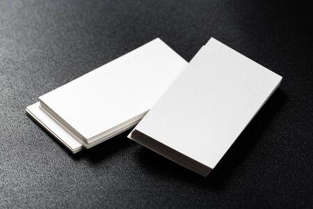 Mockup of business cards at dark background.