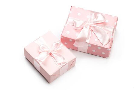 Gift box wrapped in pastel  paper with pink ribbon isolated Reklamní fotografie