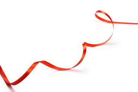 Red ribbon isolated on white background Reklamní fotografie