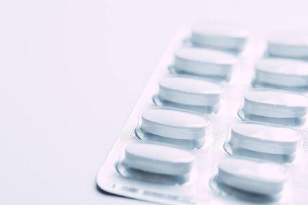 Pills in blister packs isolated on white background