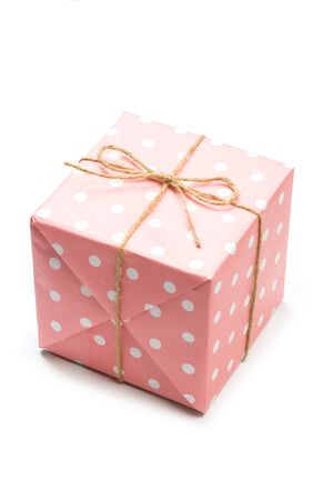 Gift box wrapped in pastel  paper with pink ribbon isolated Banco de Imagens