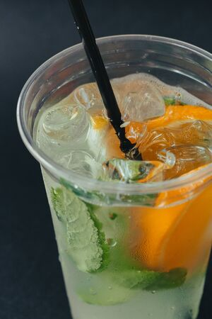 Refreshing drinks for summer, cold sweet and sour lemonade juice with ice cubes in the glasses