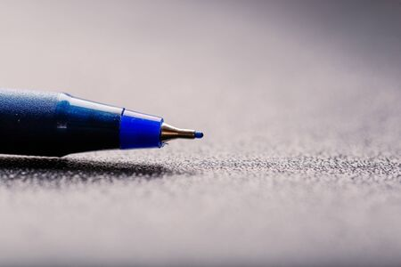 automatic plastic ballpoint pen with clipping path on black background. close up.