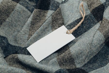 Rectangular Tag on a clothes. fashion, people and shopping concept - close up price tag of clothing item Stock fotó