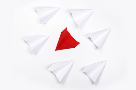 Red paper plane are different from others on white background. Think different. Business for innovative, solution concepts