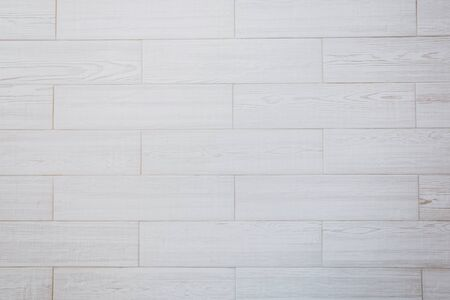 White tile wood surface as background. top view
