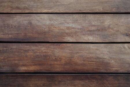 wood brown grain texture, dark wall background, top view of wooden table Stock fotó
