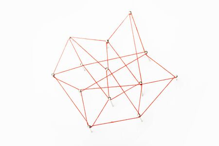A large grid of pins connected with string. Communication, network concept. Red