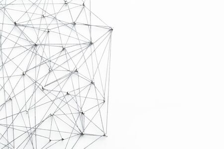 A large grid of pins connected with string. Communication, network concept