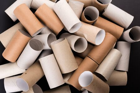 Empty Toilet paper Rolls Stack Up On a Black Background Stockfoto