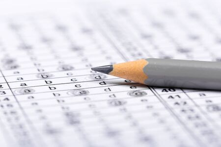 A pencil sitting on a test bubble sheet