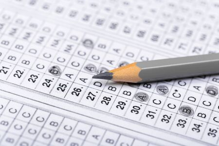 testing in exercise and exam paper. computer sheet with pencil in school test room, education concept