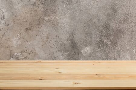 Wooden board empty table in front of a blurred background. Perspective brown wood with blurry grunge or old wall backdrop - can be used to showcase or mount your products. Mock up