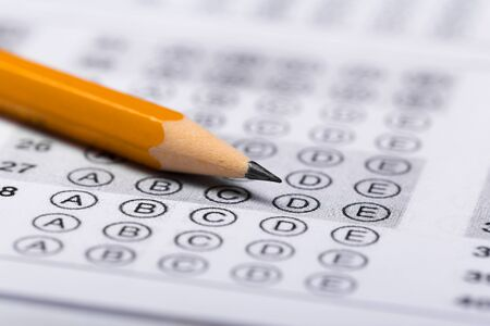 pencil for the exam. printed school test Answer sheet Stock Photo
