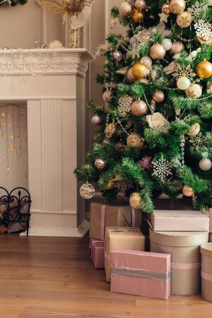 Christmas and New Year decorations with lights.Christmas tree and gift boxes left by santa claus