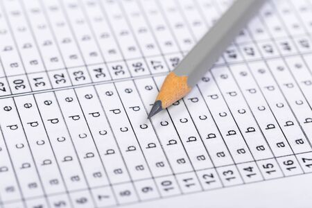 Fill in the answer sheet in the exam with a pencil Stock Photo